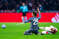 12-12-2018 NED: Champions League AFC Ajax - FC Bayern Munchen, Amsterdam<br /> Match day 6 Group E - Ajax - Bayern Munchen 3-3 / Red card Thomas Muller #25 of Bayern Munich, Nicolas Tagliafico #31 of Ajax