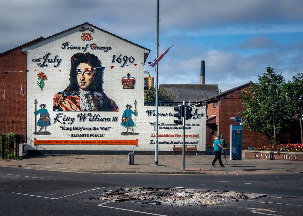The remains of a bonfire infant of a mural depicting the Protestant King William of Orange at the Battle of the Boyne, north of Dublin, in 1690 - a triumph that secured a Protestant line of succession to the British Crown. Belfast, NI.