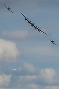 The Battle of Britain Memorial Flight, including an Avro Lancaster B1, a Supermarine Spitfire and a Hawker Hurricane - Duxford Battle of Britain Air Show taking place during IWM (Imperial War Museum) Duxford's centenary year. Duxford's principle role as a Second World War fighter station is celebrated at the Battle of Britain Air Show by more than 40 historic aircraft taking to the skies.