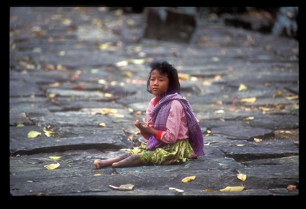 SIEM REAP, CAMBODIA: A young girl in Angkor Wat, SIem Reap, Cambodia  Photo by David Paul Morris
