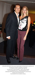 MR & MRS SEB BISHOP she was model Heidi Wichlinski former girlfriend of racing driver David Coulthard, at a party in London on 8th October 2003.PNK 55