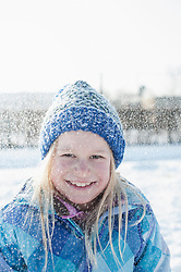 Portrait of girl in snowfall
