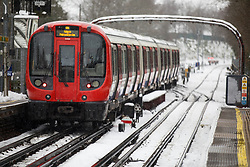© Licensed to London News Pictures. 11/12/2017. Amersham, UK. A tube train seen in the snow at Amersham tube station. Yesterday parts of the south east of England experienced heavy snow, with the home counties experiencing some of the worst conditions. There have been delays to the tube network. Photo credit : Tom Nicholson/LNP