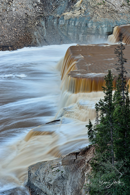 Hay River gorge at dusk and Louise Falls, Twin Falls Territorial Park, Northwest Territories, Canada