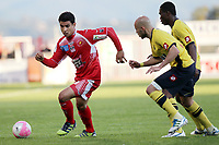 Ajaccio's midfielder Benjamin Andre (L) vies with Sochaux's defender Yassin Mikari  (2ndR) during the French L1 football match Ajaccio vs Sochaux in the Francois Coty stadium in Ajaccio, Corsica, on May 2, 2012. PHOTO PASCAL POCHARD-CASABIANCA / AFP / DPPI