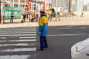 Japan elderly man working as a traffic regulator