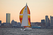 Boston, USA - Sailing in Boston harbor with the dowtown skyline in the background.  The Boston Sailing Center rents Soling class racing keelboats and cruising yachts as well as providing sailing instruction and a racing program.