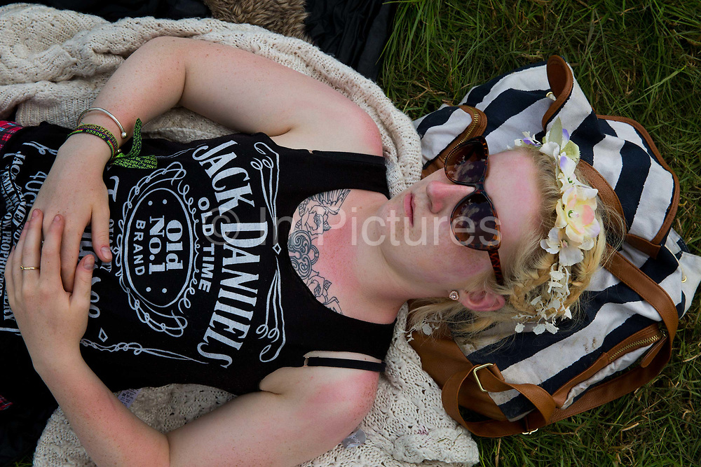 Sleeping on the grass in the Glastonbury Festival. <br /> Glastonbury Festival is the largest greenfield festival in the world, and is now attended by around 175,000 people. It's a five-day music festival that takes place near Pilton, Somerset, England. In addition to contemporary music, the festival hosts dance, comedy, theatre, circus, cabaret, and other arts. It is organised by Michael Eavis on his own land, Worthy Farm in Pilton. Leading pop and rock artists have headlined, alongside thousands of others appearing on smaller stages and performance areas.