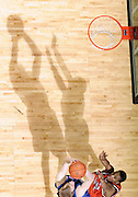 Shadows play larger than life as Virginia's Sean Singletary defends Duke's MartynasPocius during the game March 5, 2008.