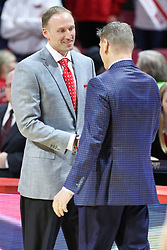 NORMAL, IL - February 02: Dan Muller greets Porter Moser during a college basketball game between the ISU Redbirds and the University of Loyola Chicago Ramblers on February 02 2019 at Redbird Arena in Normal, IL. (Photo by Alan Look)