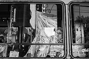 Bus passenger looks at movilization against the visit of Barack Obama, president of the United States. Buenos Aires, Argentina. March / 2016.