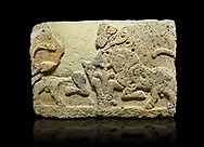 Photo of Hittite relief sculpted orthostat stone panel of Herald's Wall Limestone, Karkamıs, (Kargamıs), Carchemish (Karkemish), 900-700 B.C. Anatolian Civilisations Museum, Ankara, Turkey.<br /> <br /> A pair of kneeling bull on either side of the tree of life, one each foot is on the tree, the other feet are bend towards the abdomen.  <br /> <br /> Against a black background. .<br />  <br /> If you prefer to buy from our ALAMY STOCK LIBRARY page at https://www.alamy.com/portfolio/paul-williams-funkystock/hittite-art-antiquities.html  - Type  Karkamıs in LOWER SEARCH WITHIN GALLERY box. Refine search by adding background colour, place, museum etc.<br /> <br /> Visit our HITTITE PHOTO COLLECTIONS for more photos to download or buy as wall art prints https://funkystock.photoshelter.com/gallery-collection/The-Hittites-Art-Artefacts-Antiquities-Historic-Sites-Pictures-Images-of/C0000NUBSMhSc3Oo