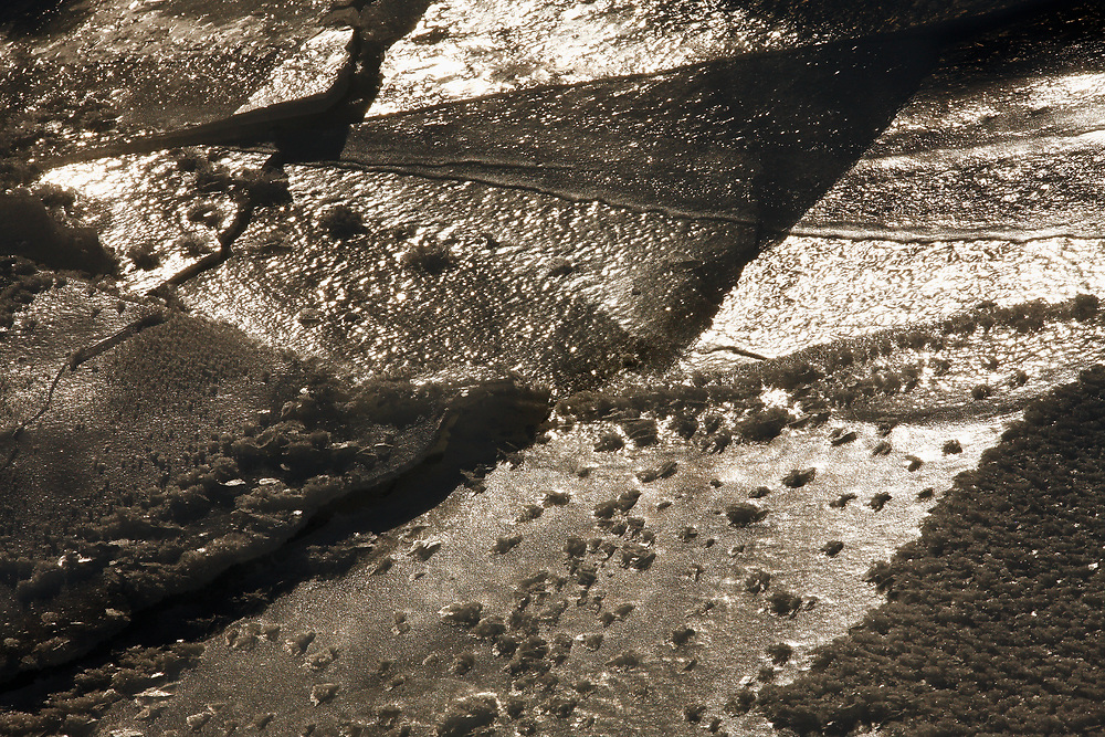 FRACTURED RIVER ICE PATTERN, MARVINE CREEK, RIO BLANCO COUNTY, COLORADO