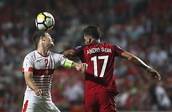 October 10, 2017 - Lisbon, Portugal - Portugal's midfielder Andre Silva  vies with Switzerland's defender Stephan Lichtsteiner during the FIFA 2018 World Cup Qualifier match between Portugal and Switzerland at the Luz Stadium on October 10, 2017 in Lisbon, Portugal. (Credit Image: © Carlos Costa/NurPhoto via ZUMA Press)