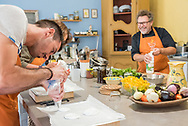 In the kitchen at Cook'n With Class in Uzes, with Chef and owner Eric Fraudeau.