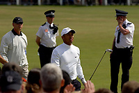Golf<br /> Foto: SBI/Digitalsport<br /> NORWAY ONLY<br /> <br /> 2005 Open Championship, St. Andrews.<br /> Saturday 16/07/2005<br /> <br /> Tiger Woods drives off 2nd with his security man behind him and 2 local bobbies in close attendance