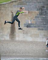 Kids Tombstoning off the Port Walls in Charlestown near St Austell Bay Cornwall  photo Brian Jordan