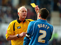Photo: Ed Godden.<br />Reading v Wolverhampton Wanderers. Coca Cola Championship. 18/03/2006. <br />Referee, Mr P.Walton show Graeme Murty the yellow card.