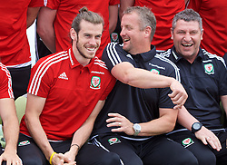 DINARD, FRANCE - Tuesday, June 7, 2016: Wales' Gareth Bale jokes with goalkeeping coach Martyn Margetson as players prepare for a team group photograph at the Novotel Thalasso Dinard ahead of the start of the UEFA Euro 2016 tournament. (Pic by Paul Greenwood/Propaganda)