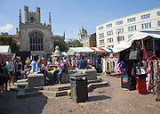 People in historic market place in the city centre of Cambridge, England