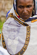 A refugee woman from Central African Republic wears a cloth with the image of her president in the village of Tongo Gandima, near Bertoua, Cameroon, on Tuesday September 15, 2009.