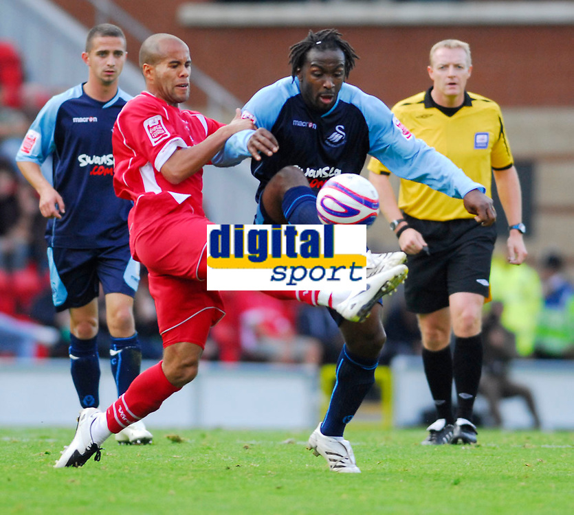 Photo: Leigh Quinnell.<br /> Leyton Orient v Swansea City. Coca Cola League 1. 06/10/2007. swanseas Jason Scotland battles with Orients Adam Chambers.