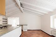 Empty white room with terracotta floor. Nobody inside