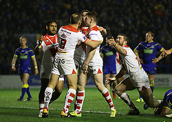 Helens Mark Percival (second right) celebrates after scoring the opening try of the game against Warrington Wolves during the Betfred Super League match at The Halliwell Jones Stadium, Warrington.