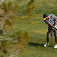 062913  Adron Gardner/Independent<br /> <br /> Gary Reeves swings iron at Fox Run Golf Course during the Bengal Cheer Golf Tournament in Gallup Saturday.