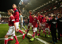 Bristol City walk out to face Manchester United with the mascots - Mandatory by-line: Robbie Stephenson/JMP - 20/12/2017 - FOOTBALL - Ashton Gate Stadium - Bristol, England - Bristol City v Manchester United - Carabao Cup Quarter Final