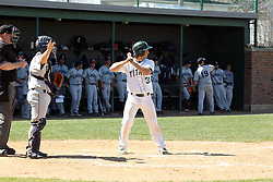 14 April 2013:  A.J. Nathan bats, Zach Tsiodras catches, Steve Jones umpires during an NCAA division 3 College Conference of Illinois and Wisconsin (CCIW) Baseball game between the Elmhurst Bluejays and the Illinois Wesleyan Titans in Jack Horenberger Stadium, Bloomington IL