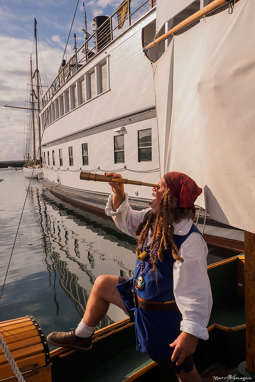 North America, United States, Washington, Port Townsend. Pirate on boat at annual Wooden Boat Festival.  MR