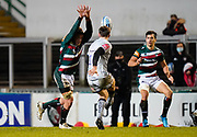 Leicester Tigers flanker Hanro Liebenberg attempts to charge down kick from Sale Sharks fly-half AJ McGinty during a Gallagher Premiership Round 7 Rugby Union match, Friday, Jan. 29, 2021, in Leicester, United Kingdom. (Steve Flynn/Image of Sport)