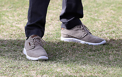 Prince Harry, shoe detail, plays tennis as he attends a youth sports festival at the Sir Vivian Richards Stadium in North Sound, Antigua, on the second day of his tour of the Caribbean.