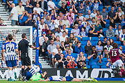 Mathew Ryan (GK)(Brighton) & Lewis Dunk (Capt) (Brighton) down on the pitch joined by Dan Burn (Brighton) as Jeff Hendrick (Burnley) runs to celebrate his goal during the Premier League match between Brighton and Hove Albion and Burnley at the American Express Community Stadium, Brighton and Hove, England on 14 September 2019.