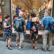 Shopping near Ponte Vecchio along the River Arno in Florence, Italy.