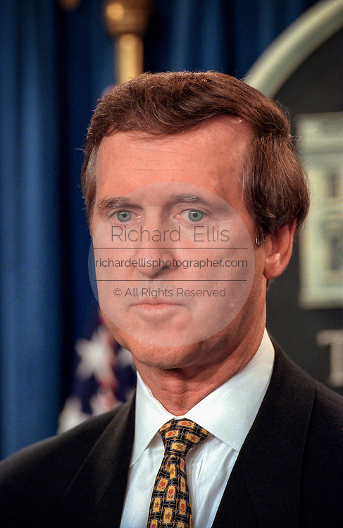 US Secretary of Defense William Cohen looks on as President Bill Clinton makes a statement in the Briefing Room of the White House November 15, 1998 in Washington, DC. Clinton announced that he called off airstrikes on Iraq after Saddam Hussein agreed to allow the UN to resume weapon inspections.