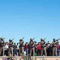 Navajo Nation police officers give a traditional 21 gun solute during the internment ceremony of Officer Houston Largo held at Sunset Memorial Park in Gallup Thursday March 16.