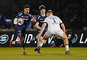 Sale Sharks wing Denny Solomona runs at London Irish prop Harry Elrington during a Gallagher Premiership Rugby Union match, won by Sharks 39-0, Friday, Mar. 6, 2020, in Eccles, United Kingdom. (Steve Flynn/Image of Sport)