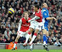 Photo: Ed Godden.<br />Arsenal v Portsmouth. The Barclays Premiership. 16/12/2006. Arsenal's Jeremie Aliadiere (centre) heads a shot at goal.