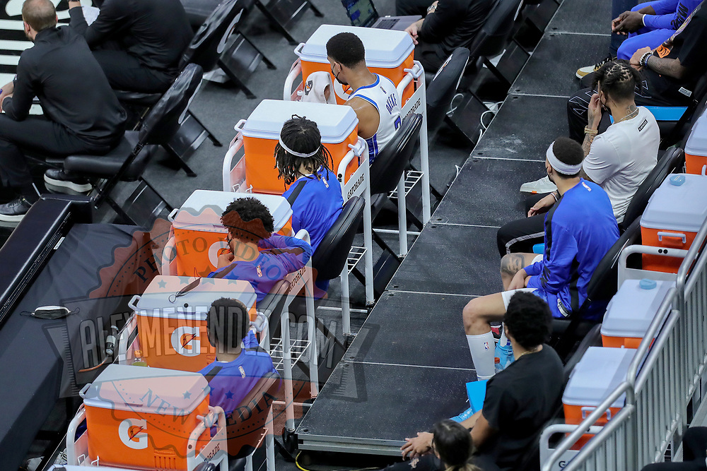 ORLANDO, FL - APRIL 12: Orlando Magic players are socially distanced on the sideline during a game against the San Antonio Spurs at Amway Center on April 12, 2021 in Orlando, Florida. NOTE TO USER: User expressly acknowledges and agrees that, by downloading and or using this photograph, User is consenting to the terms and conditions of the Getty Images License Agreement. (Photo by Alex Menendez/Getty Images)*** Local Caption ***