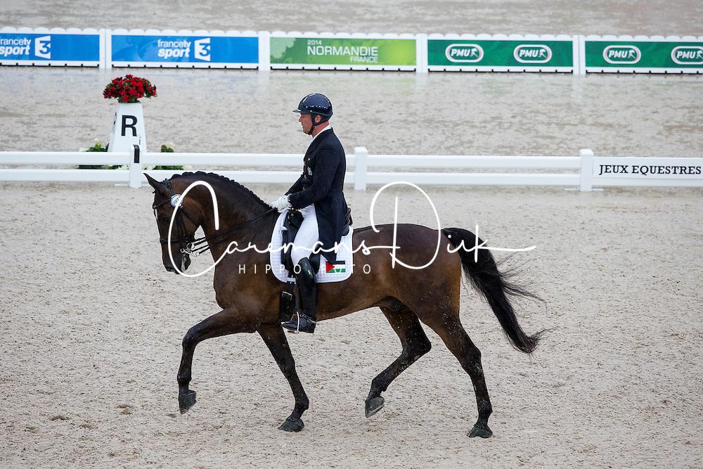 Christian Bruhe, (PLE), Cinco De Mayo - Grand Prix Team Competition Dressage - Alltech FEI World Equestrian Games™ 2014 - Normandy, France.<br /> © Hippo Foto Team - Leanjo de Koster<br /> 25/06/14