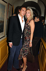 IAIN RUSSELL and MISS OLIVIA BUCKINGHAM at a private dinner and presentation of Issa's Autumn-Winter 2005-2006 collection held at Annabel's, 44 Berkeley Square, London on 15th March 2005.<br /><br />NON EXCLUSIVE - WORLD RIGHTS