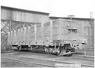 """3/4 view of D&RGW high-side gondola #1554 at the Durango roundhouse.<br /> D&RGW  Durango, CO  Taken by Payne, Andy M. - 3/17/1969<br /> In book """"Narrow Gauge Pictorial, Vol. III: Gondolas, Boxcars and Flatcars of the D&RGW"""" page 50"""