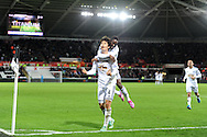 Ki Sung-Yueng of Swansea city © celebrates with Nathan Dyer after he scores his teams 1st goal. Barclays Premier league match, Swansea city v Queens Park Rangers at the Liberty stadium in Swansea, South Wales on Tuesday 2nd December 2014<br /> pic by Andrew Orchard, Andrew Orchard sports photography.