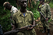 Young Tutsi rebels from CDNP (Congré National pour la Defense du Peuple) holding Kalashnikovs in Bunagana, in March 17, 2008, where the commander of Laurent Nkunda, was reportedly arrested by the Congolese-Rwandan joint forces in January, 2009. The armed conflict between different rebels and government forces had resulted in hundreds of thousands of deaths and more than 1.4 million internally displaced persons in the Eastern Congo from 2004 until now. The sexual violence was rampant towards women and children, which left them dead or mentally and physically traumatized.