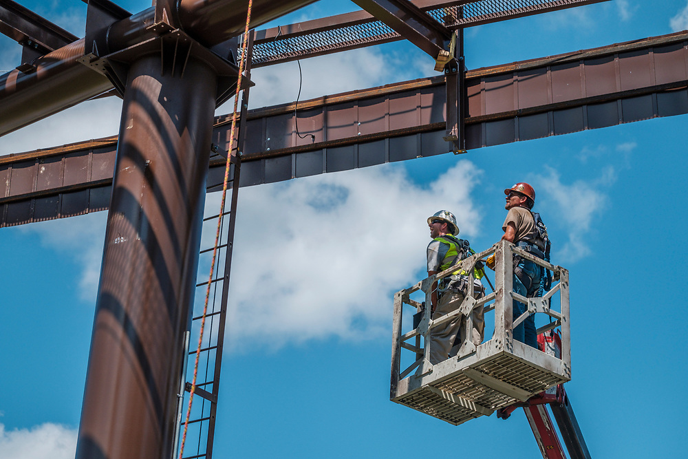 Rick Handy, left, and Greg Gentry work from a bucket high above the ground to secure the billboard structure to it's base as technicians from Lamar Advertising install a digital billboard structure along Wards Road in Lynchburg, VA Wednesday, August 29, 2018. U.S. companies are investing in re-training efforts to fill a slew of open positions as a tight labor market and changing job requirements makes it hard to find qualified staffers.<br /> CREDIT: Justin Ide for The Wall Street Journal<br /> RETRAIN