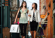 SHOT 3/9/2007 - Shopping on Larimer Square in downtown Denver, Co. Larimer Square defines style and sophistication for someone as unique as you. For shopping and dining in the Mile High City, Larimer Square epitomizes urban chic - from the latest vogue looks, to the newest culinary endeavors and captivating, nouveau cocktails. Only here will you find that little extra something from a host of shops, restaurants, and hot spots that are sure to enchant you. Larimer Square is a historic shopping and dining district in Denver..NOTE: These are models from a shoot for Larimer Square.(Photo by Marc Piscotty © 2007)