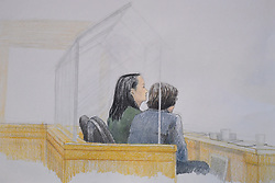 In this courtroom sketch, Meng Wanzhou, left, the chief financial officer of Huawei Technologies, sits with a translator during a bail hearing at B.C. Supreme Court in Vancouver, BC, Canada on Monday, December 10, 2018. Photo by Jane Wolsak/CP/ABACAPRESS.COM