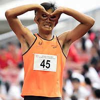 Chong Wei Guan (#45) of Singapore Sports School celebrates after finishing first with a timing of 11.06s in the A Division boys' 100m final. (Photo © Eileen Chew/Red Sports)